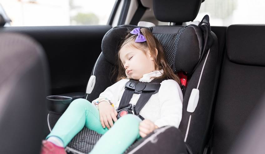 Child sleeping in a car because of control over noise vibration and harshness sound damping.